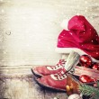 Boots and a hat of Santa Claus with Christmas decorations — Stock Photo