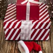 Two vintage gift boxes and Santa hat — Stock Photo