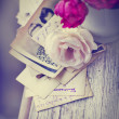 Stock Photo: Roses with old letters and postcards