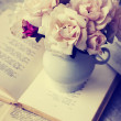 Roses on old books — Stock Photo