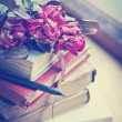 Dry roses on old books — ストック写真