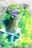 Lilacs in metal watering can — Stock Photo