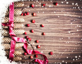 Pinecones and red Christmas ribbon — Foto Stock