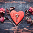 Key with heart and dry roses — Stock Photo