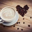 Coffee cup with heart — Stock Photo