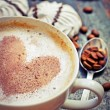 Stock Photo: Cup of aromatic coffee with heart and coffee beans