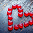 Red heart shaped candies — Stock Photo #38707375