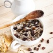 Stock Photo: Bowl of oat flake with raisins and milk