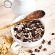Bowl of oat flake with raisins and milk — Stock Photo