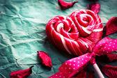 Lollipop and petals — Stock Photo