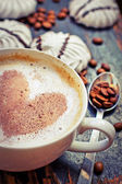 Cup of aromatic coffee with heart and coffee beans — Stock Photo