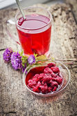 Raspberry hot drink , jam and flowers — Stock Photo