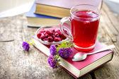 Books, tea, jam and flowers — Stock Photo