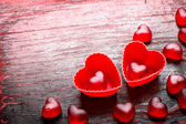 Red heart shaped candies — Stock Photo