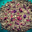 Tea leaves with petals — Stock Photo