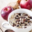 Bowl of oat flakes with raisins, milk and apples — Stock Photo