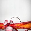 Decorative red ribbon with heart and bow — Stock Photo
