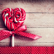 Stock Photo: Red heart-shaped lollipop