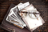 Vintage photos and glasses — Stock Photo