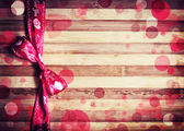 Decorative red ribbon with bow — Stock Photo