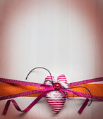 Decorative red ribbon with heart and bow — Stok fotoğraf