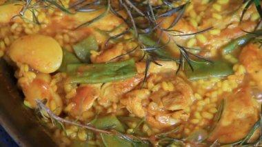 Spanish typical paella with pilgrim — Stock Video