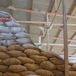 Warehouse and Sacks stacked — Stock Photo #13720626