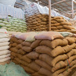 Warehouse and Sacks stacked — Stock Photo #13754753