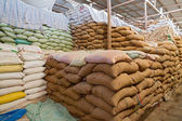 Warehouse and Sacks stacked — Stock Photo