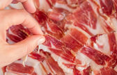 Picking serrano ham — Stock Photo