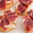 Spanish tapas, ham and tomato - Stock Photo