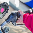 Woman pumping gasoline — Foto de Stock