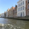 Sailing over canal with vintage houses and bridge in Brugge, Belgium — Stock Video