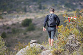 Hard marathon mountain race, descent — Stock Photo