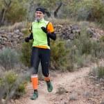 Hard marathon mountain race descent — Stock Photo #22012477