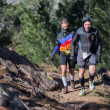 Hard mountain race, friends - Stock Photo