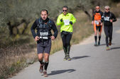 Harte marathonlauf mountain, road — Stockfoto