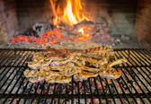 Lamb chops on grill — Stock Photo