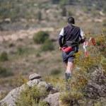 Постер, плакат: Hard marathon mountain race descent