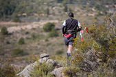 Hard marathon mountain race, descent — Stock Photo