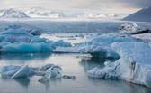Blue icebergs floating — Stock Photo