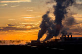 Sunset and factory — Stock Photo