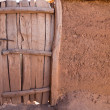 Old wooden door and adobe wall — Stock Photo #46357773