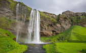 Wide view of Seljalandsfoss, the waterfall in Iceland — Stock Photo