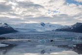 Glacier tonque and mountains — Stock Photo