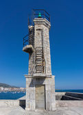 Stone Lighthouse over blue sky — Stock fotografie