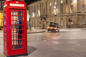 Classic red British telephone box, night scene — Stock Photo