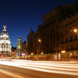 MADRID, SPAIN - FEBRUARY 14: Night view of Madrid with Metropolis Building and GrViStreet, main shopping street in Madrid, on February 14, 2013 in Madrid — Stock Photo #22468295