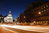 MADRID, SPAIN - FEBRUARY 14: Night view of Madrid with Metropolis Building and Gran Via Street, the main shopping street in Madrid, on February 14, 2013 in Madrid — Stock Photo