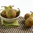 Pears in white bowl - Stock Photo